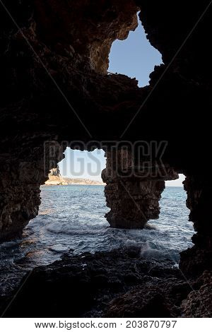 Cave of the arches in the cove of Moraig in Valencia. Spain.