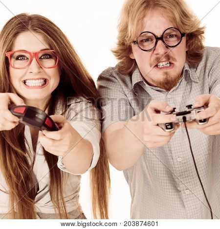 Happy couple enjoying leisure time by playing video games together. Studio shot isolated