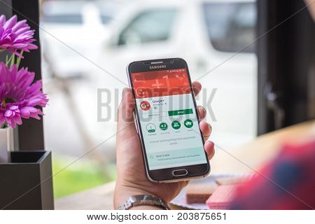 Chiang Mai, Thailand - September 12, 2017: Samsung Galaxy S6 smartphone launches google plus application on the desk screen at the coffee shop.