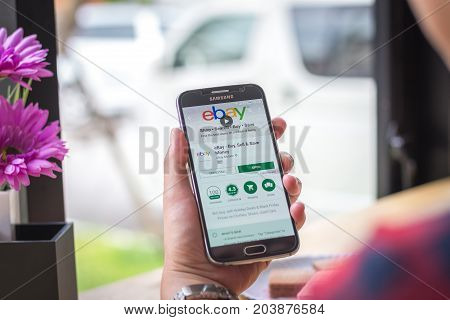 Chiang Mai, Thailand - September 12, 2017: Samsung Galaxy S6 smartphone launches ebay application on the desk screen at the coffee shop.