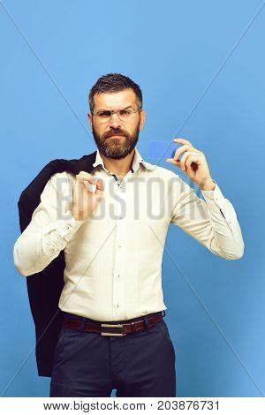 Guy With Serious Face And Glasses Isolated On Blue Background