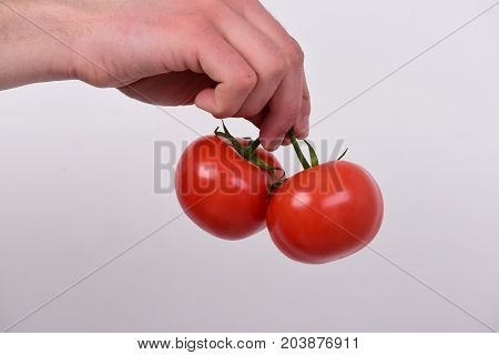Tomatoes In Bright And Juicy Color. Health And Nutrition Concept.
