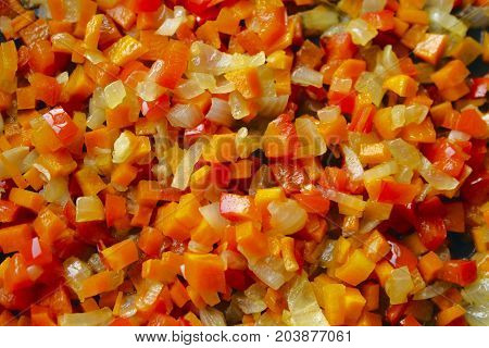 The mixed vegetables background. Stir-fried vegetables close-up. Vegetables background. Stir-fried mixed vegetables.