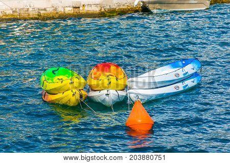 MONTENEGRO PERAST - JUNE 04/2017: tourists parked their boats near the coast of the Boka Kotorska Bay.