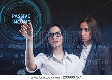 The concept of business technology the Internet and the network. A young entrepreneur working on a virtual screen of the future and sees the inscription: Passive income