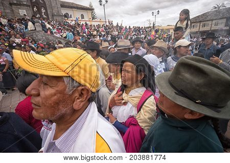 April 14 2017 CotacachiEcuador: indigenous kechwa crowd at the Easter procession watching the reenacting of crucifixion