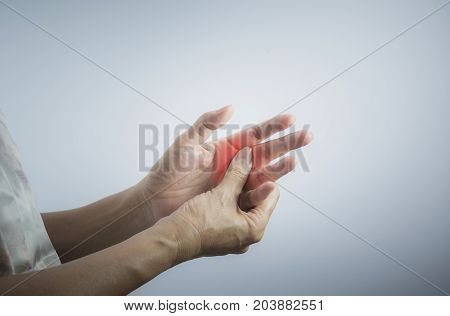 Woman massaging her painful hand. Woman holding her hand pain concept.