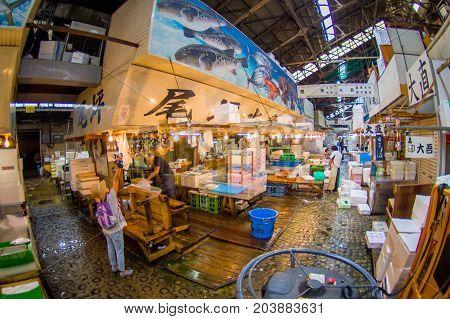 TOKYO, JAPAN JUNE 28 - 2017: Seafood for sale at the Fish Market Tsukiji wholesale in Tokyo Japan, Tsukiji Market is the biggest wholesale fish and seafood market in the world. Fish eye effect.