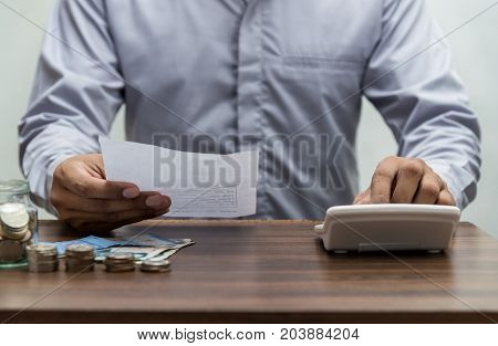 Man With Bill And Stack Of Coin On Business Office Table Vintage Style