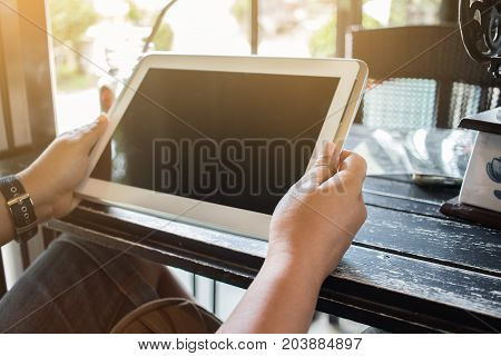 Businesswoman holds tablet sync app Using Online banking payment by network internet wireless development mobile smartphone for Business shopping in coffee shop Internet concept.