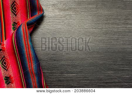 Multicolor pattern cloth on wooden table for background. Fabric texture. Wooden texture.Template for designers