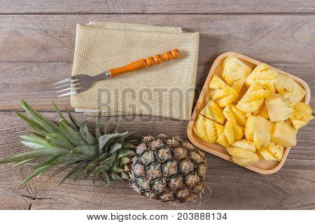 Pineapple on wooden background, pineapple is a tropical fruit.