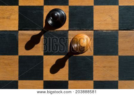 top view Chess Pawns stand on chessboard with shadows
