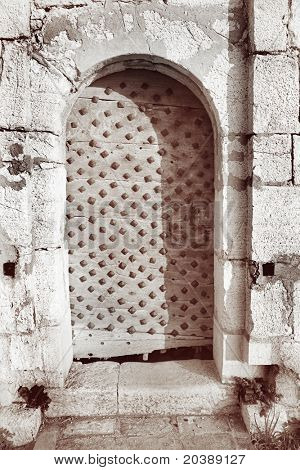 Entrance to the Fort de L'Ile Sainte-Marguerite, Cannes, France - contrasty sepia