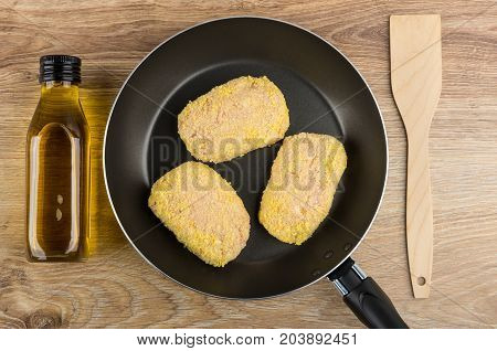 Raw Cutlet In Frying Pan, Vegetable Oil And Spatula