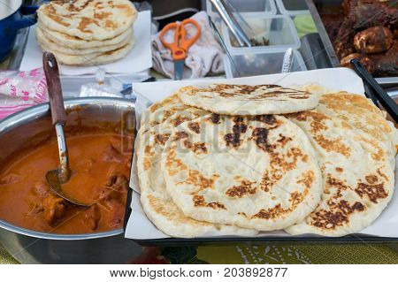Roti canai  with spicy curry (Islamic food)