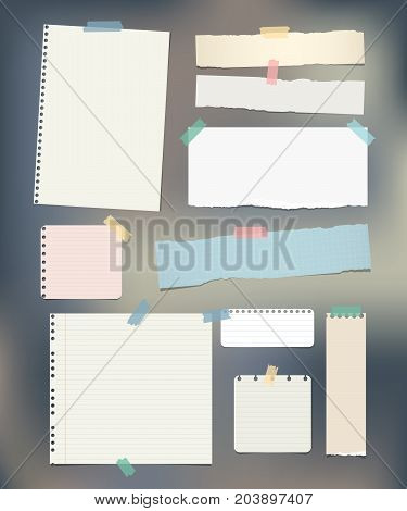 Torn ruled, note, notebook, copybook paper strips, sheets stuck with sticky tape on colorful background