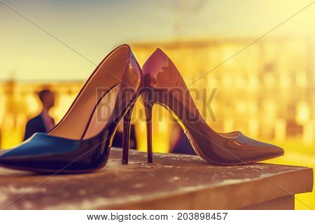 Bridal Accessories - Bordeaux Colour Bride Shoes On Stair Railings. Vintage Tone