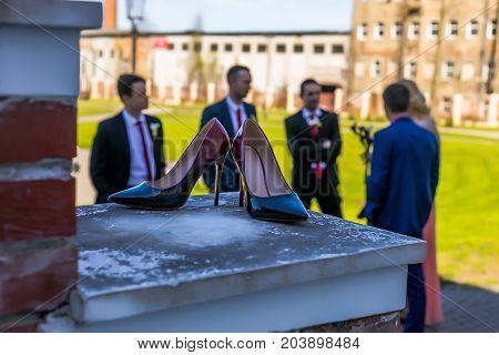 Bridal Accessories - Bordeaux Colour Bride Shoes On Stair Railings