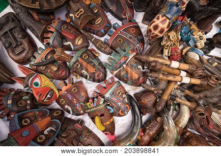 April 29 2017 Otavalo Ecuador: indigenous quechua face masks made of wood selling on the street in the Saturday market