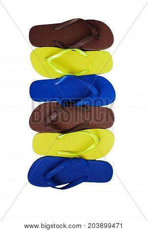 Several Pairs Of Multi-colored Rubber Flip-flops Exhibited In A Row, Isolated