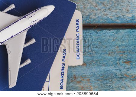 airplane on a passport with air tickets close-up on a wooden background.