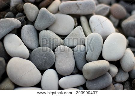 stones on the beach, grey stones, many stones