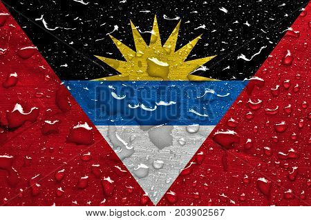 flag of Antigua and Barbuda with rain drops