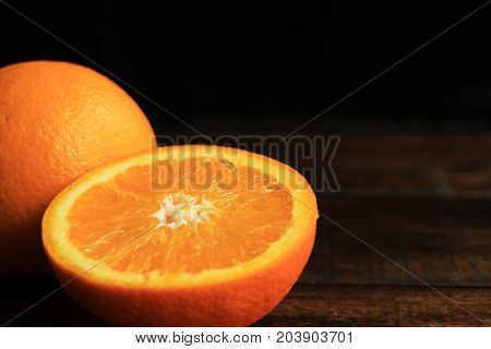 Orange Fruit on Wooden Table with Space for Text