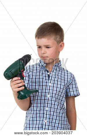 A young thoughtful builder boy in the plaid shirt holds a screwdriver, isolated on white background.