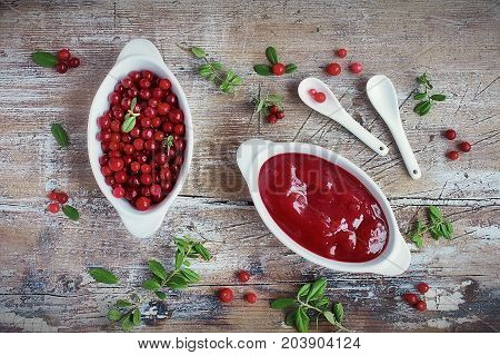 homemade sauce from the forest lingonberry and fresh lingonberry and cowberry leaf