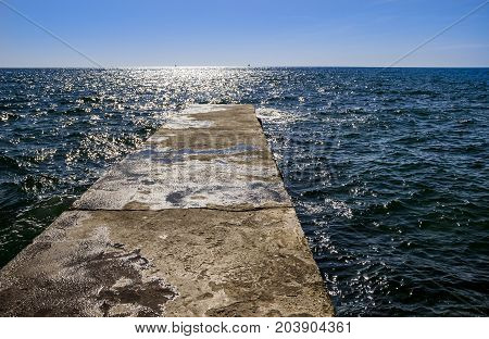 close-up of old stone pier at the sea