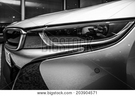 BERLIN - NOVEMBER 28 2014: Showroom. A fragment of the car BMW i8 first introduced as the BMW Concept Vision Efficient Dynamics is a plug-in hybrid sports car developed by BMW. Black and white.