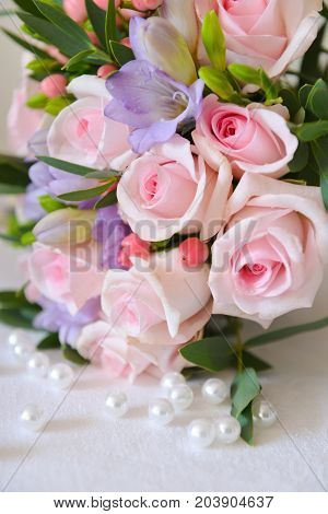 gentle pink bouquet of the bride stands on the table background