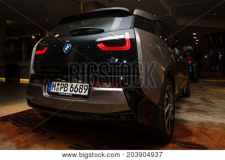 BERLIN - NOVEMBER 28 2014: Showroom. The BMW i3 previously Mega City Vehicle (MCV) is a five-door urban electric car developed by the German manufacturer BMW. Rear view.