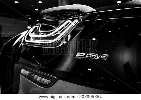 BERLIN - NOVEMBER 28 2014: Showroom. The rear lights of the car BMW i8 first introduced as the BMW Concept Vision Efficient Dynamics is a plug-in hybrid sports car developed by BMW. Black and white