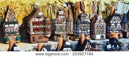 Nuremberg, Germany - December 24, 2016: Nuremberg symbol half-timbered house miniature at Christmas market stall