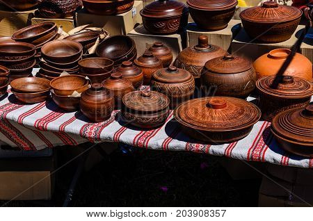 Different Wooden Pots For Sale On A Fair