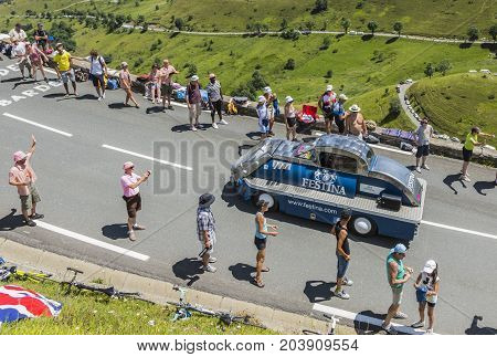 Col de PeyresourdeFrance- July 23 2014: Festina vehicle during the passing of the Publicity Caravan on the road to Col de Peyresourde in Pyrenees Mountains in the stage 17 of Le Tour de France on 23 July 2014.