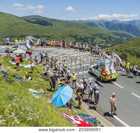 Col de PeyresourdeFrance- July 23 2014: Belin vehicle passing in the Publicity Caravn on the road to Col de Peyresourde in Pyrenees Mountains during the stage 17 of Le Tour de France 2014.