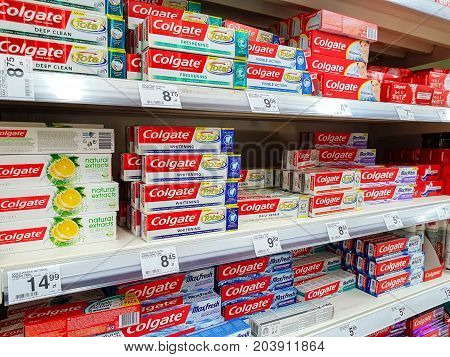 Nowy Sacz Poland - July 06 2017: Various Colgate toothpaste products for sale in the Carrefour Hypermarket. Colgate is a brand of toothpaste produced by Colgate-Palmolive Company.