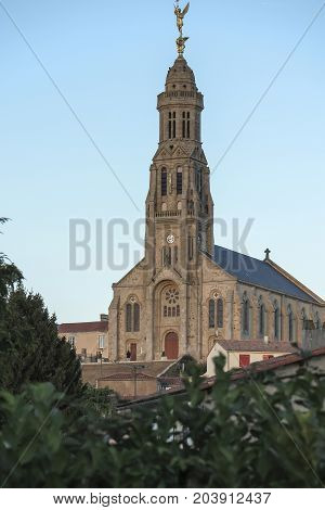Church of Saint Michael in Saint-Michel-Mont-Mercure France with a large figure of the Archangel Michael at the top of the tower