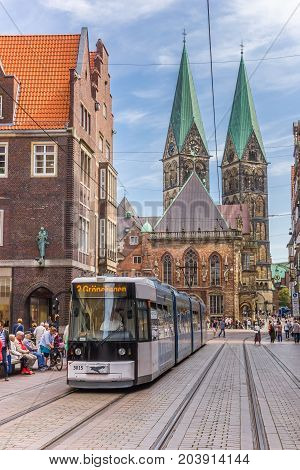 BREMEN, GERMANY - AUGUST 23, 2017: Tram in front of the Dom church in Bremen, Germany