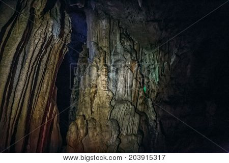 Huge beautiful stalactites in the underground cave, toned