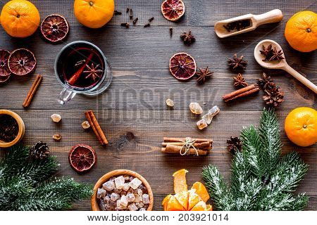 Celebrate new year winter evening with hot drink. Mulled wine or grog ingredients. Wooden desk background top view.