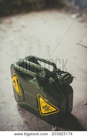 Terrorism. Molotov Cocktail. Green Military Jerrycan With Empty Bottles