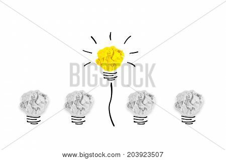 Creative concept. Yellow light bulb outstanding on bulb crumpled paper on white background