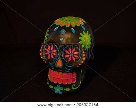 A black sugar skull for Dias de la muerte or day of the dead a mexican celebration.