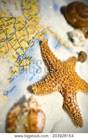 Sand and seashells pictured with a map of the Gulf of Mexico.