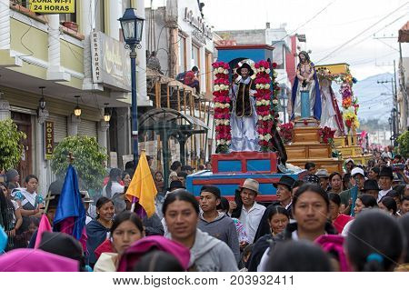 April 14 2017 Cotacachi Ecuador: heavy religious floats are being carried through the streets during Easter procession